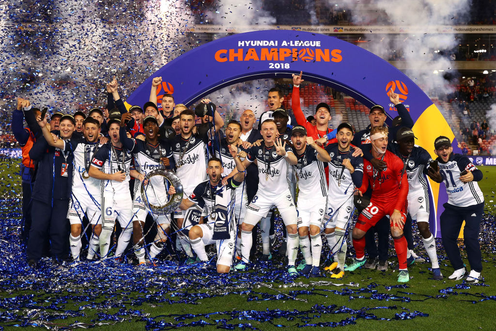 Melbourne Victory celebrate with the trophy