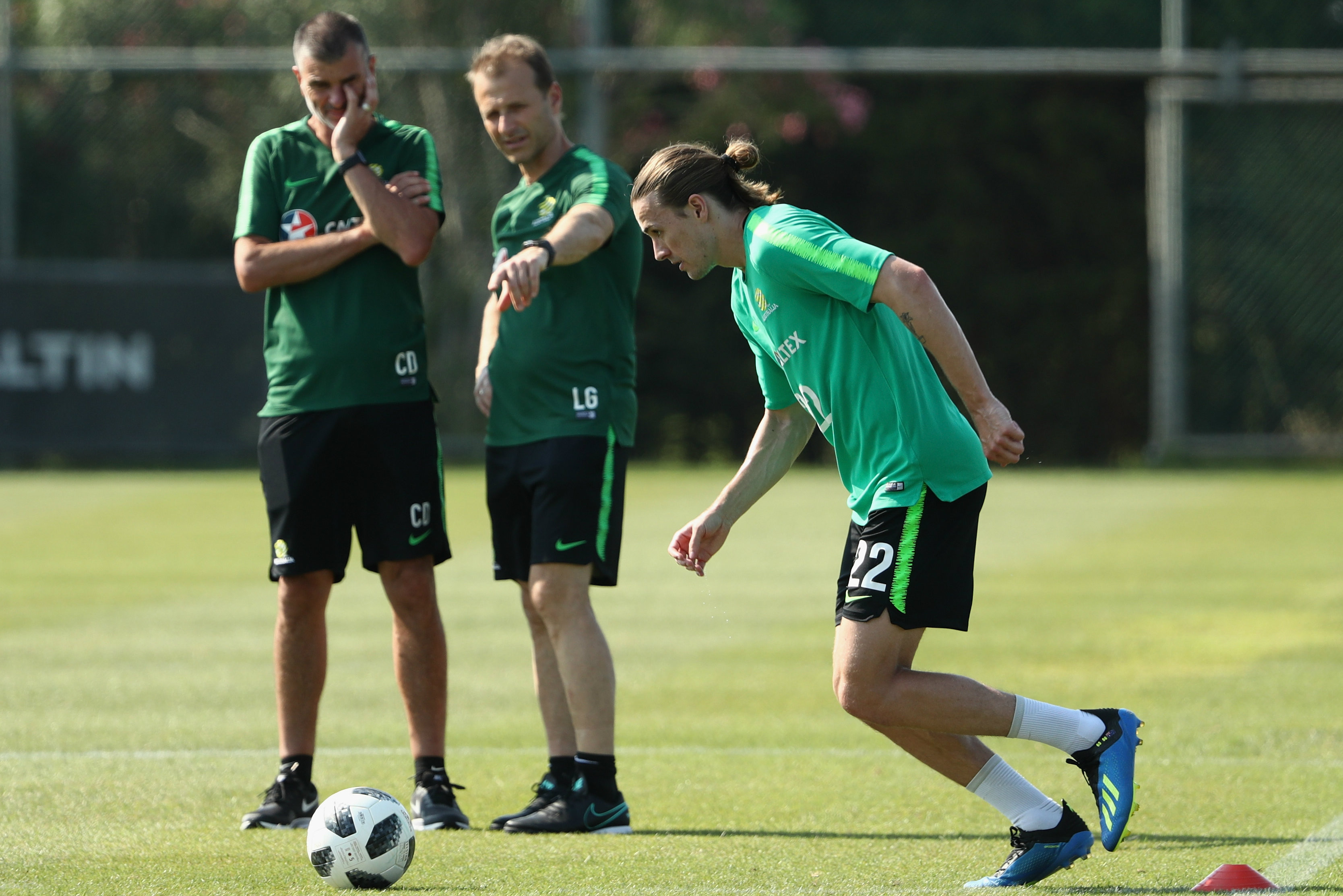 Craig Duncan and Les Gelis look on at Jackson Irvine during Socceroos training.