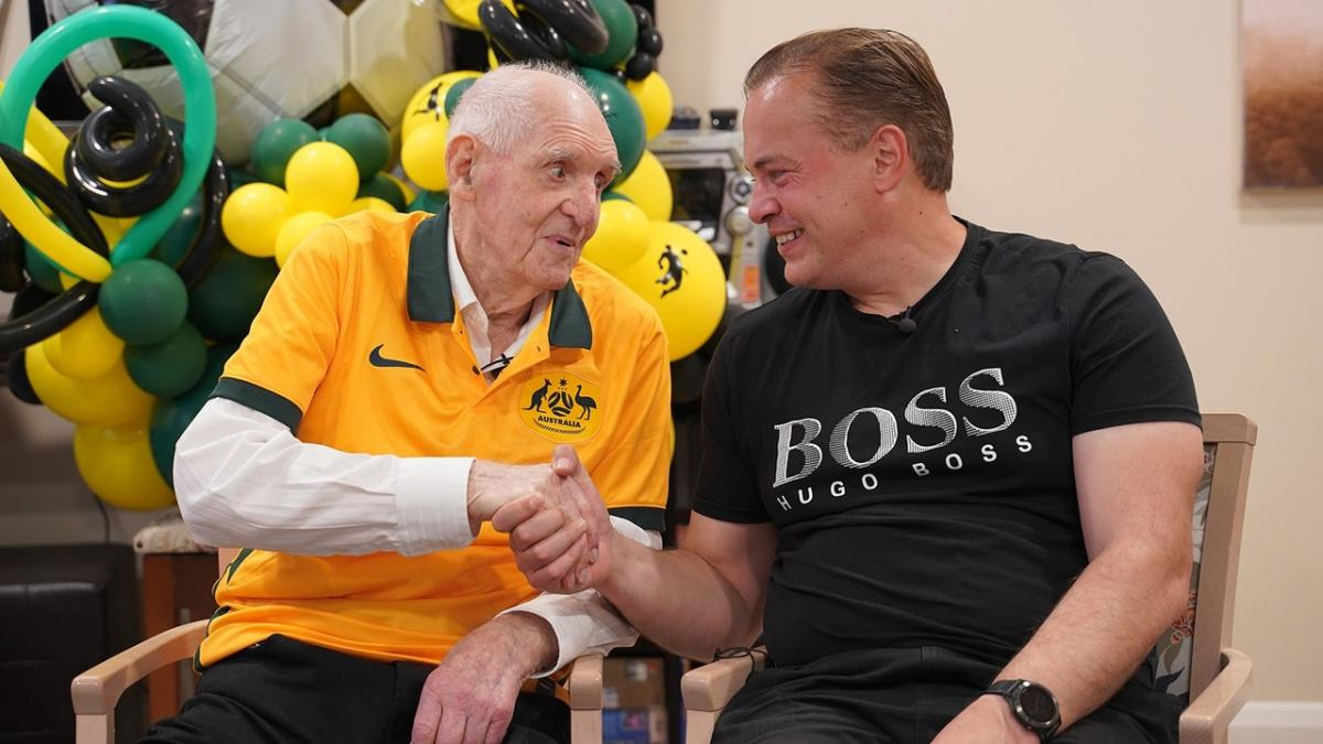 Former Socceroo Alan Garside presented with special kit gift