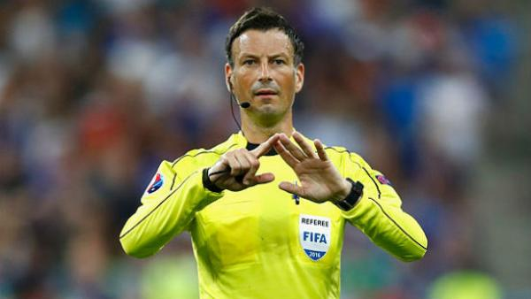 FIFA referee Mark Clattenburg gestures for a football during the Euro 2016 final.